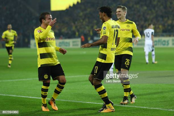 PierreEmerick Aubameyang of Dortmund celebrates his goal to make it 40 with Mario Goetze of Dortmund and Lukasz Piszczek of Dortmund during the...