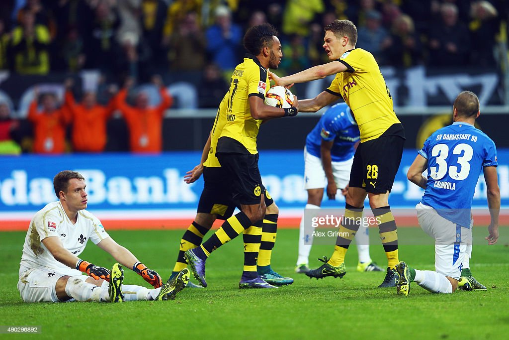 Pierre-Emerick Aubameyang of Dortmund celebrates his team's first goal with team mate Matthias Ginter during the Bundesliga match between Borussia Dortmund and SV Darmstadt 98 at Signal Iduna Park on September 27, 2015 in Dortmund, Germany.