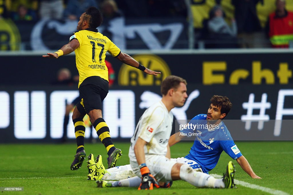 Pierre-Emerick Aubameyang of Dortmund celebrates his team's second goal as goalkeeper Christian Mathenia and Gyorgy Garics of Darmstadt react during the Bundesliga match between Borussia Dortmund and SV Darmstadt 98 at Signal Iduna Park on September 27, 2015 in Dortmund, Germany.