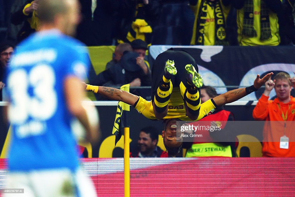 Pierre-Emerick Aubameyang of Dortmund celebrates his team's second goal as Luca Caldirola of Darmstadt reacts during the Bundesliga match between Borussia Dortmund and SV Darmstadt 98 at Signal Iduna Park on September 27, 2015 in Dortmund, Germany.