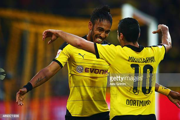 PierreEmerick Aubameyang of Dortmund celebrates his team's third goal with team mate Henrikh Mkhitaryan during the Bundesliga match between Borussia...