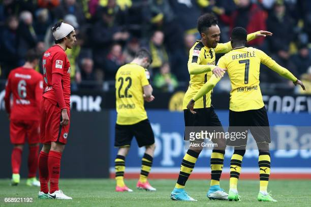 PierreEmerick Aubameyang of Dortmund celebrates his team's third goal with team mates Ousmane Dembele during the Bundesliga match between Borussia...