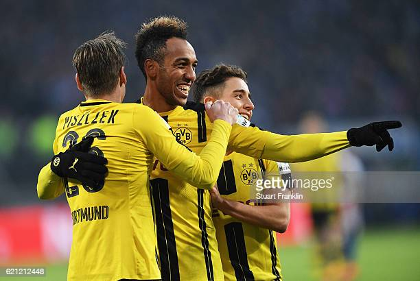 PierreEmerick Aubameyang of Dortmund celebrates scoring his fourth goal during the Bundesliga match between Hamburger SV and Borussia Dortmund at...