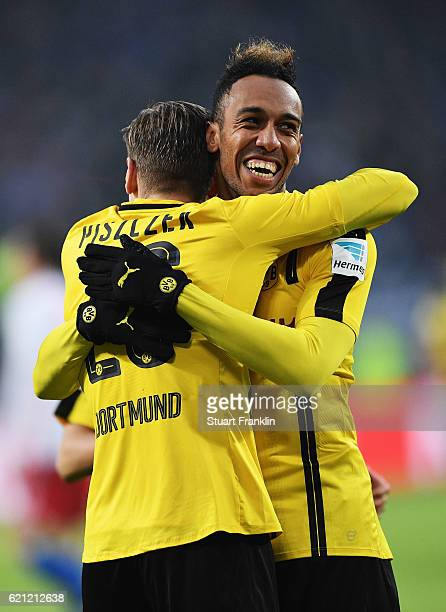 PierreEmerick Aubameyang of Dortmund celebrates scoring his fourth goal with Christian Pulisic during the Bundesliga match between Hamburger SV and...