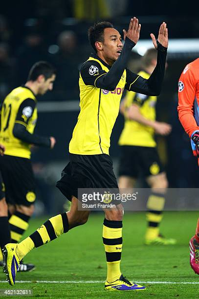 PierreEmerick Aubameyang of Dortmund celebrates scoring his team's third goal during the UEFA Champions League Group F match between Borussia...