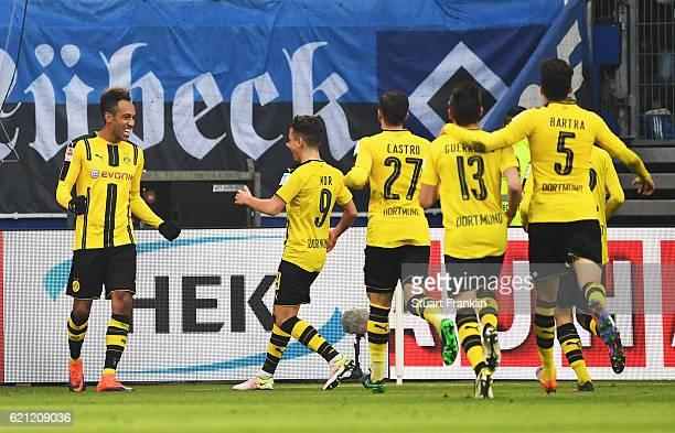 PierreEmerick Aubameyang of Dortmund celebrates scoring his third goal during the Bundesliga match between Hamburger SV and Borussia Dortmund at...