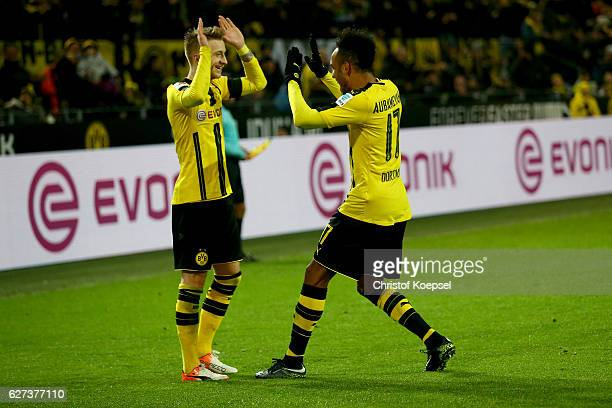 PierreEmerick Aubameyang of Dortmund celebrates the forth goal with Marco Reus during the Bundesliga match between Borussia Dortmund and Borussia...