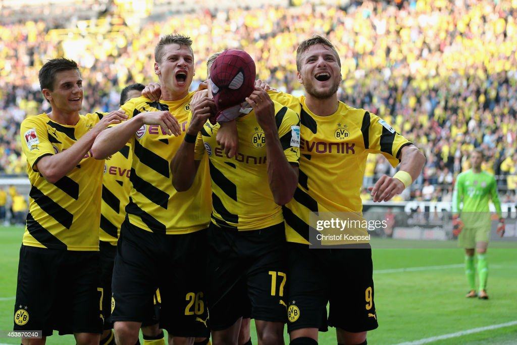 Pierre-Emerick Aubameyang (2nd R) of Dortmund celebrates the second goal with Jonas Hofmann (L), Lukasz Piszczek (2nd R) and Ciro Immobile of Dortmund (R) during the DFL Supercup match between Borussia Dortmund and FC Bayern Muenchen at Signal Iduna Park on August 13, 2014 in Dortmund, Germany.