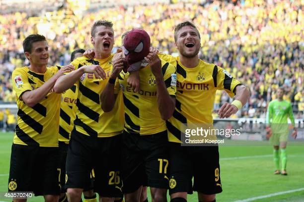PierreEmerick Aubameyang of Dortmund celebrates the second goal with Jonas Hofmann Lukasz Piszczek and Ciro Immobile of Dortmund during the DFL...