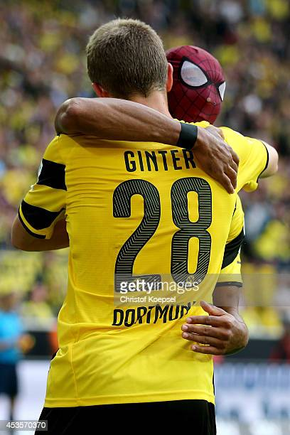 PierreEmerick Aubameyang of Dortmund celebrates the second goal with a mask with Matthias Ginter of Dortmund during the DFL Supercup match between...