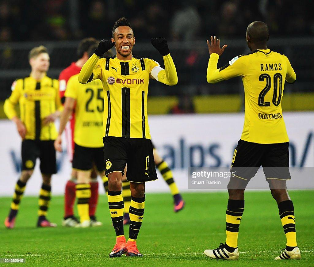 Pierre-Emerick Aubameyang of Dortmund celebrates with Adrián Ramos at the end of the Bundesliga match between Borussia Dortmund and Bayern Muenchen at Signal Iduna Park on November 19, 2016 in Dortmund, Germany.