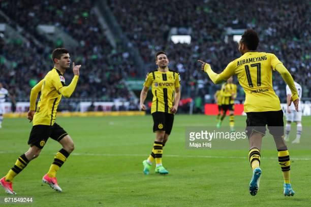 PierreEmerick Aubameyang of Dortmund celebrates with Christian Pulisic of Dortmund after scoring a goal to make it 22 during the Bundesliga match...