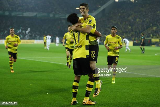 PierreEmerick Aubameyang of Dortmund celebrates with Christian Pulisic of Dortmund after he scored his teams fifth goal to make it 50 during the...