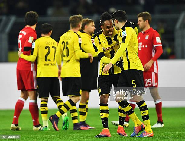 PierreEmerick Aubameyang of Dortmund celebrates with Marc Bartra at the end of the Bundesliga match between Borussia Dortmund and Bayern Muenchen at...