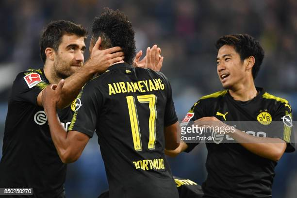 PierreEmerick Aubameyang of Dortmund celebrates with Sokratis Papastathopoulos of Dortmund and Shinji Kagawa of Dortmund after he scores his teams...