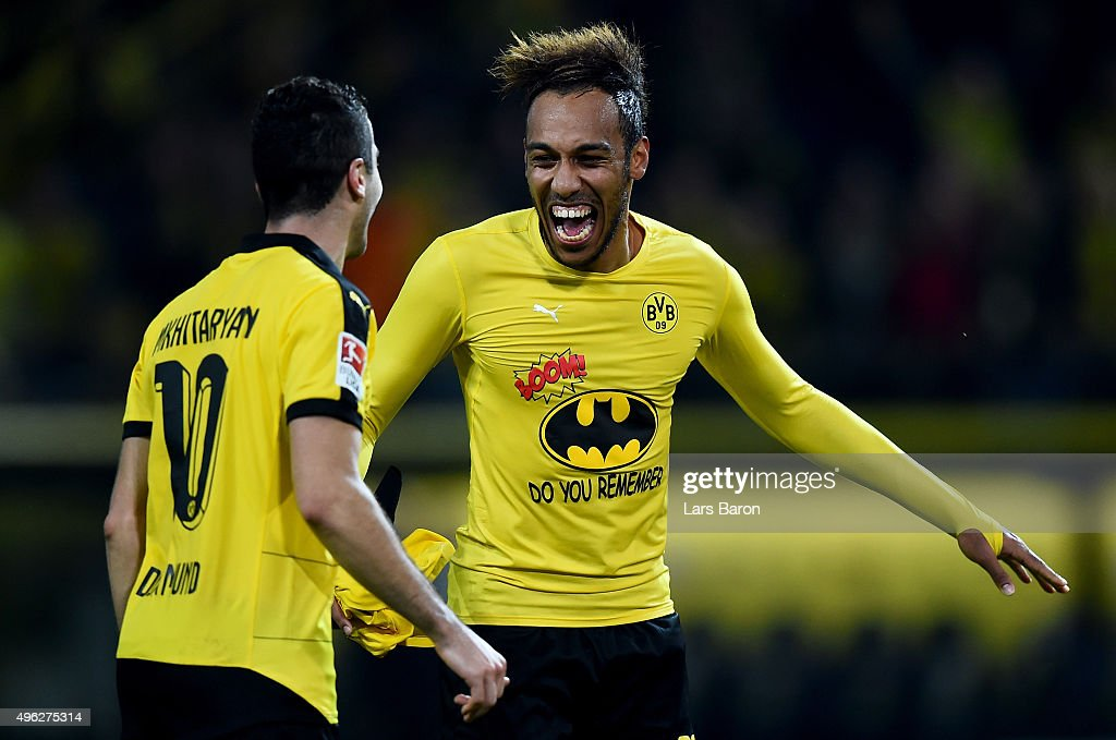 Pierre-Emerick Aubameyang of Dortmund celebrates with team mate Henrikh Mkhitaryan of Dortmund after winning the Bundesliga match between Borussia Dortmund and FC Schalke 04 at Signal Iduna Park on November 8, 2015 in Dortmund, Germany.