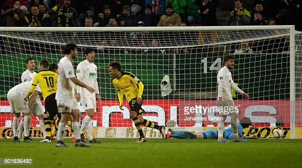 PierreEmerick Aubameyang of Dortmund celebrates with team mates after scoring his team's 2nd goal during the round of sixteen German Cup match...