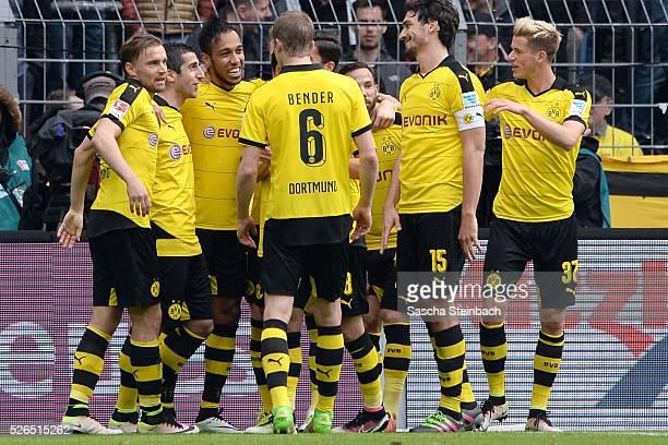 PierreEmerick Aubameyang of Dortmund celebrates with team mates after scoring his team's fifth goal during the Bundesliga match between Borussia...