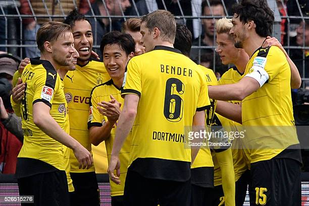 PierreEmerick Aubameyang of Dortmund celebrates with team mates after scoring his team's fifth goal during the Bundesliga match between Borussia...