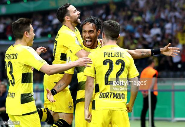 PierreEmerick Aubameyang of Dortmund celebrates with team mates after scoring his team's second goal from the penalty spot during the DFB Cup final...