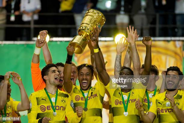 PierreEmerick Aubameyang of Dortmund celebrates with the trophy after winning the DFB Cup final match between Eintracht Frankfurt and Borussia...