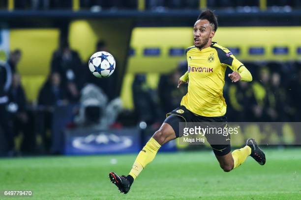 PierreEmerick Aubameyang of Dortmund controls the ball during the UEFA Champions League Round of 16 second leg match between Borussia Dortmund and SL...