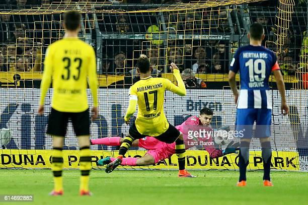 PierreEmerick Aubameyang of Dortmund fails to score over Rune Jarstein goalkeeper of Berlin by penalty kick during the Bundesliga match between...