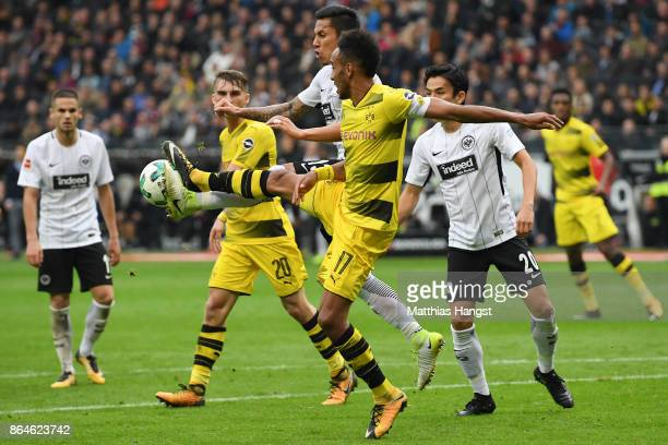 PierreEmerick Aubameyang of Dortmund fights for the ball with Carlos Salcedo of Frankfurt during the Bundesliga match between Eintracht Frankfurt and...