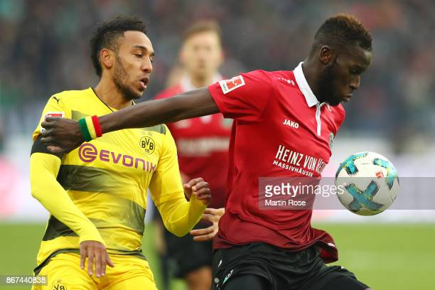 PierreEmerick Aubameyang of Dortmund fights for the ball with Salif Sane of Hannover during the Bundesliga match between Hannover 96 and Borussia...