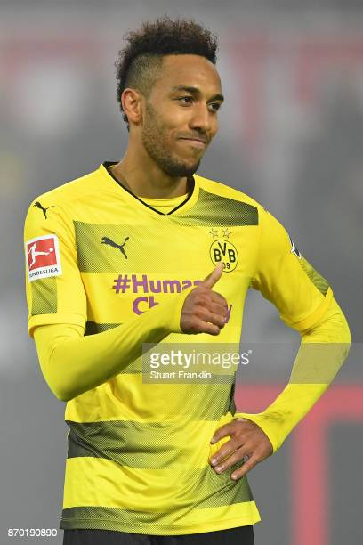 PierreEmerick Aubameyang of Dortmund gives a thumbs up as he looks dejected during the Bundesliga match between Borussia Dortmund and FC Bayern...