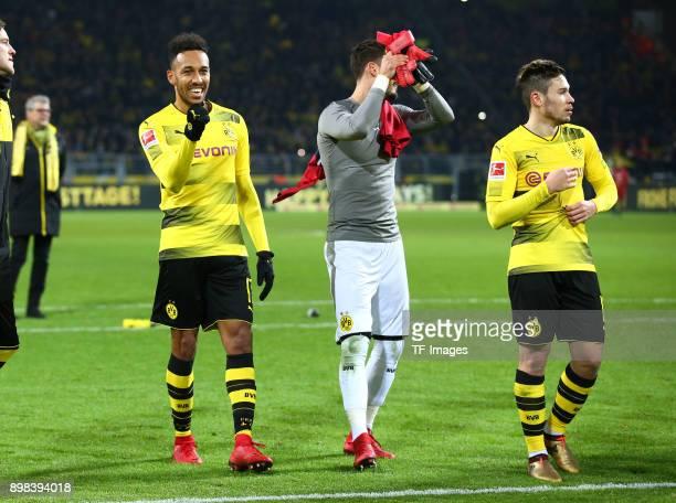 PierreEmerick Aubameyang of Dortmund Goalkeeper Roman Buerki of Dortmund and Raphael Guerreiro of Dortmund celebrate after winning the Bundesliga...