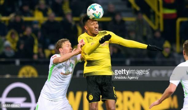 PierreEmerick Aubameyang of Dortmund in action against Florian Kainz of Werder Bremen during Bundesliga soccer match between Borussia Dortmund and...