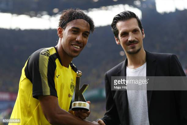 PierreEmerick Aubameyang of Dortmund is awarded the Best Player of the Season Award by a Kicker editor ahead of the Bundesliga match between Borussia...