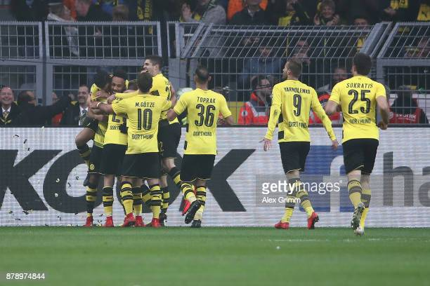 PierreEmerick Aubameyang of Dortmund is celebrated by his team mates after he scored a goal to make it 10 during the Bundesliga match between...