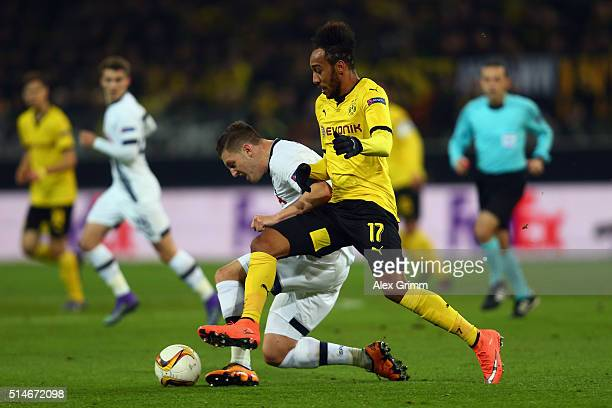 PierreEmerick Aubameyang of Dortmund is challenged by Kevin Wimmer of Tottenham during the UEFA Europa League Round of 16 first leg match between...