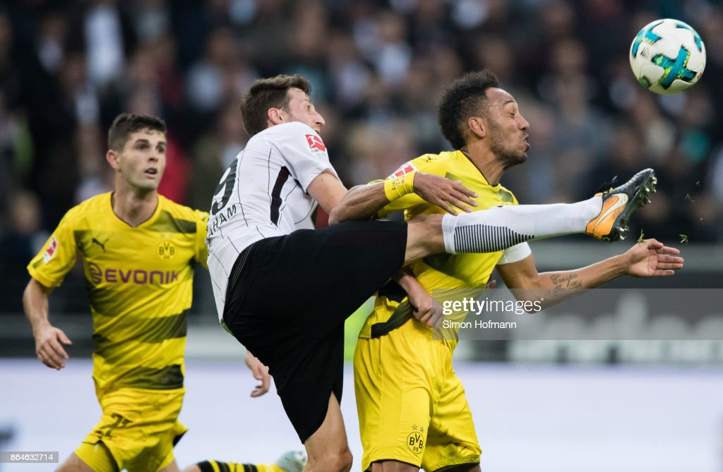 Pierre-Emerick Aubameyang of Dortmund is tackled by David Abraham of Frankfurt during the Bundesliga match between Eintracht Frankfurt and Borussia Dortmund at Commerzbank-Arena on October 21, 2017 in Frankfurt am Main, Germany.