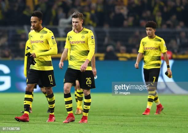 PierreEmerick Aubameyang of Dortmund Lukasz Piszczek of Dortmund and Jadon Malik Sancho of Dortmund look dejected after the Bundesliga match between...