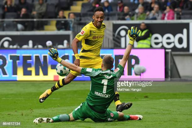 PierreEmerick Aubameyang of Dortmund misses a chance against goalkeeper Lukas Hradecky of Frankfurt during the Bundesliga match between Eintracht...