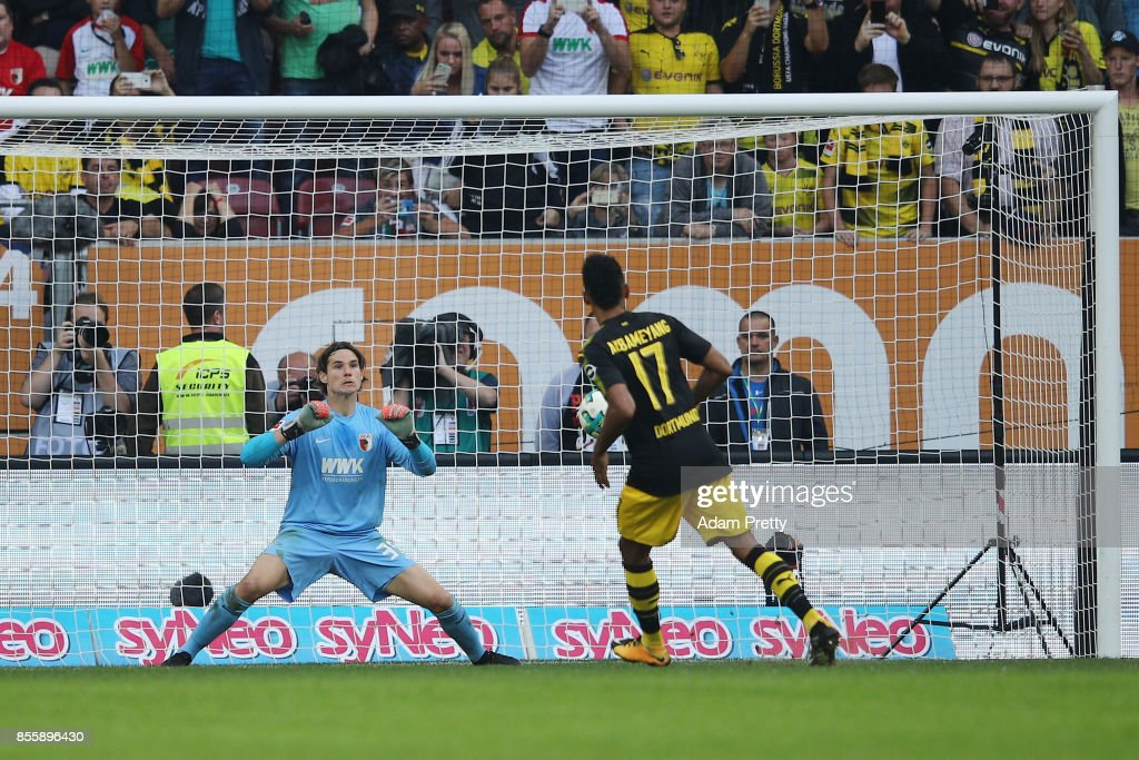Pierre-Emerick Aubameyang of Dortmund (17) misses a penalty against Marwin Hitz of Augsburg during the Bundesliga match between FC Augsburg and Borussia Dortmund at WWK-Arena on September 30, 2017 in Augsburg, Germany.