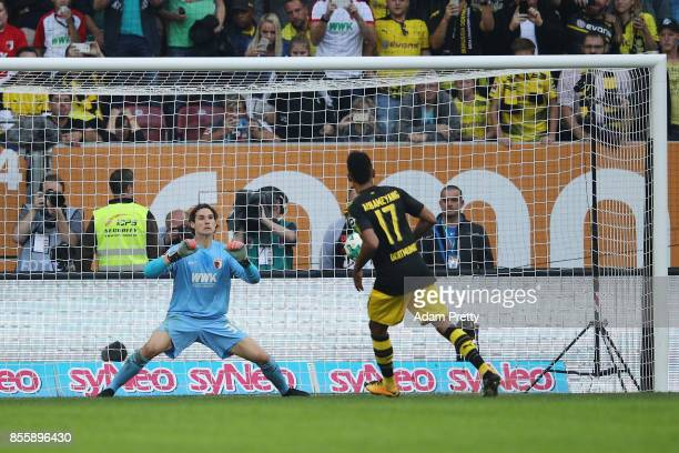 PierreEmerick Aubameyang of Dortmund misses a penalty against Marwin Hitz of Augsburg during the Bundesliga match between FC Augsburg and Borussia...