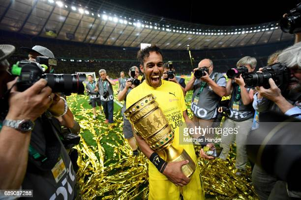 PierreEmerick Aubameyang of Dortmund poses for a photograph with the trophy after winning the DFB Cup Final 2017 between Eintracht Frankfurt and...