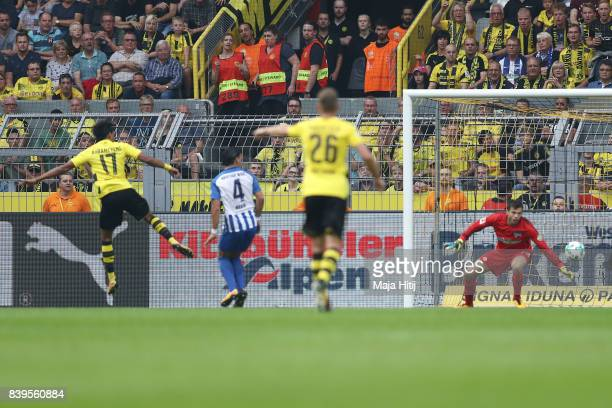 PierreEmerick Aubameyang of Dortmund scored past goalkeeper Rune Jarstein of Berlin to make it 10 during the Bundesliga match between Borussia...