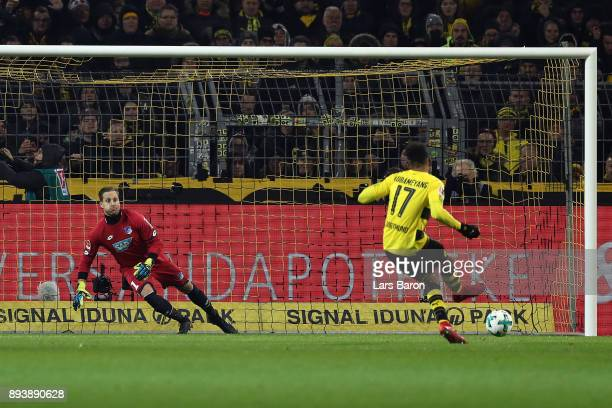 Pierre-Emerick Aubameyang of Dortmund scores a goal from the penally spot to make it 1:1 past goalkeeper Oliver Baumann of Hoffenheim during the...