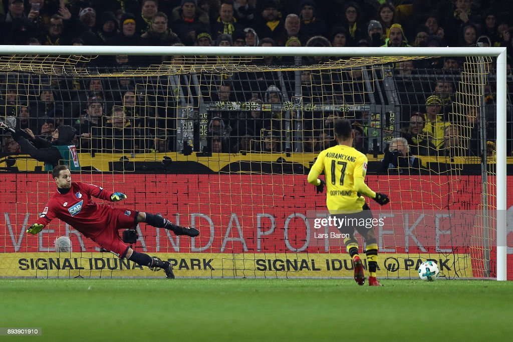 Pierre-Emerick Aubameyang of Dortmund scores a goal from the penally spot to make it 1:1 past goalkeeper Oliver Baumann of Hoffenheim during the Bundesliga match between Borussia Dortmund and TSG 1899 Hoffenheim at Signal Iduna Park on December 16, 2017 in Dortmund, Germany.