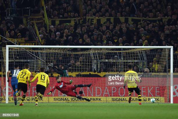 PierreEmerick Aubameyang of Dortmund scores a goal from the penally spot to make it 11 past goalkeeper Oliver Baumann of Hoffenheim during the...