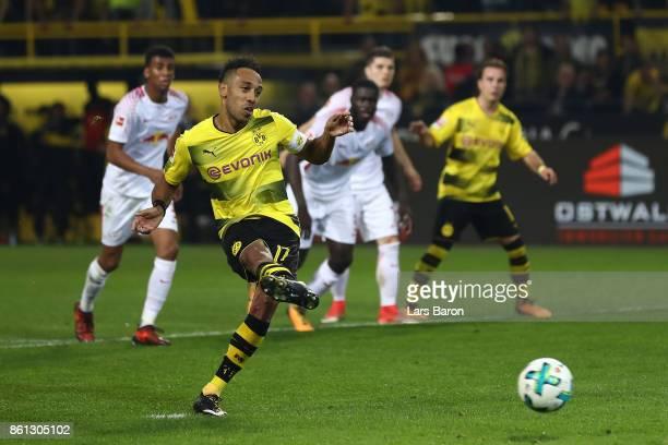 PierreEmerick Aubameyang of Dortmund scores a penalty goal to make it 23 during the Bundesliga match between Borussia Dortmund and RB Leipzig at...