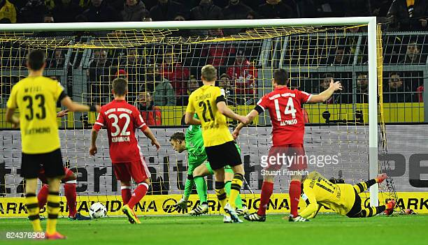 PierreEmerick Aubameyang of Dortmund scores his goal during the Bundesliga match between Borussia Dortmund and Bayern Muenchen at Signal Iduna Park...