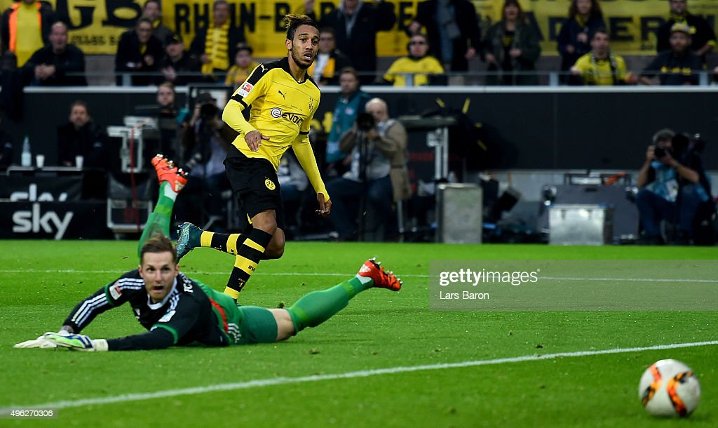 Pierre-Emerick Aubameyang of Dortmund scores his teams third goal during the Bundesliga match between Borussia Dortmund and FC Schalke 04 at Signal Iduna Park on November 8, 2015 in Dortmund, Germany.