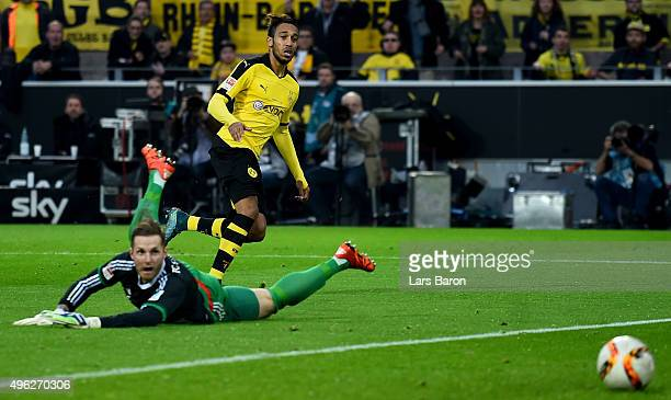 PierreEmerick Aubameyang of Dortmund scores his teams third goal during the Bundesliga match between Borussia Dortmund and FC Schalke 04 at Signal...