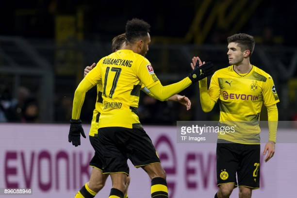 PierreEmerick Aubameyang of Dortmund shakes hands with Christian Pulisic of Dortmund torjubel during the Bundesliga match between Borussia Dortmund...